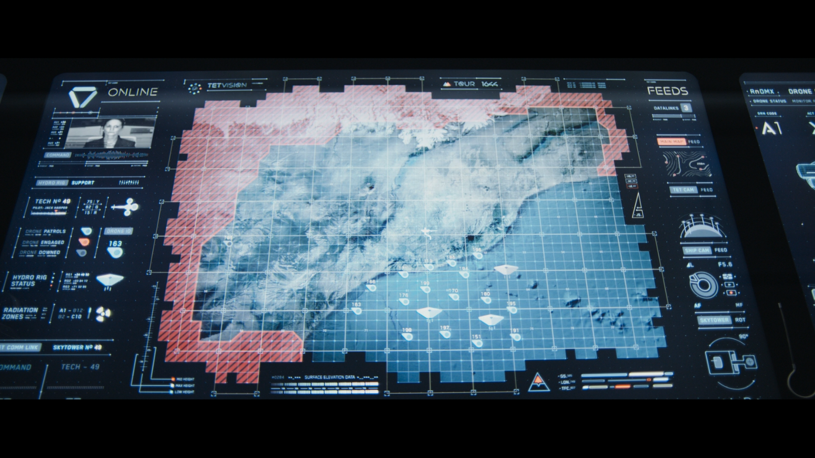 Large touch-based light table from the movie Oblivion cropped in to data that is showing alerts. The interface design in Oblivion is complex and detailed.