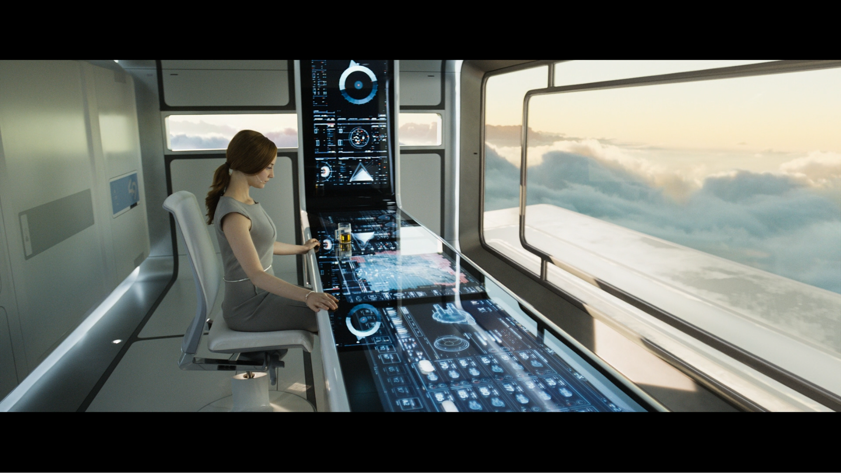 Victoria from the movie Oblivion at main control center. The control center is a touchable interface with lots of infographic data, showing the interface design in Oblivion.
