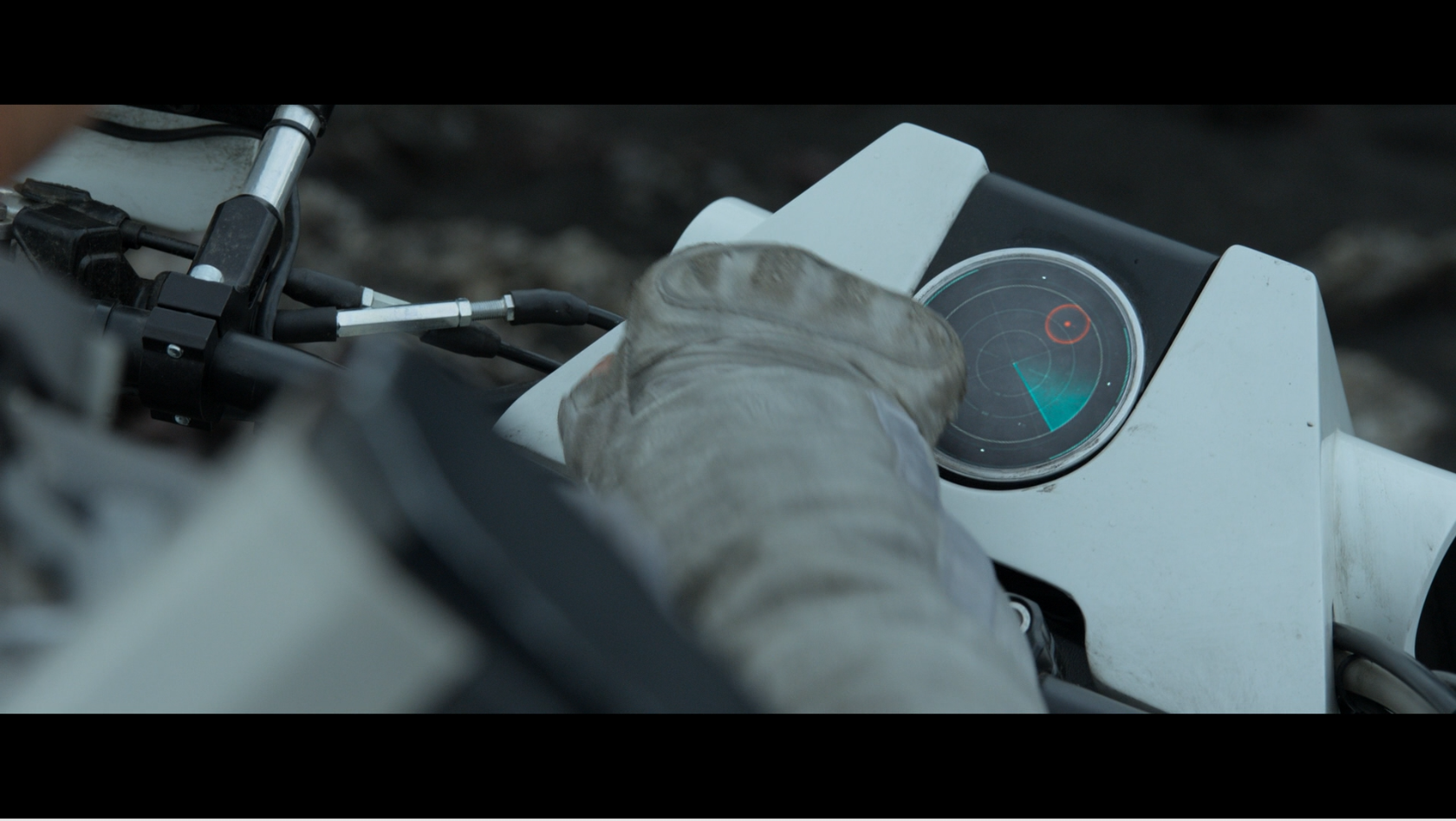 A still of the interface design in Oblivion showing Jack's motorcycle interface display indicating the positions of drones he is tracking