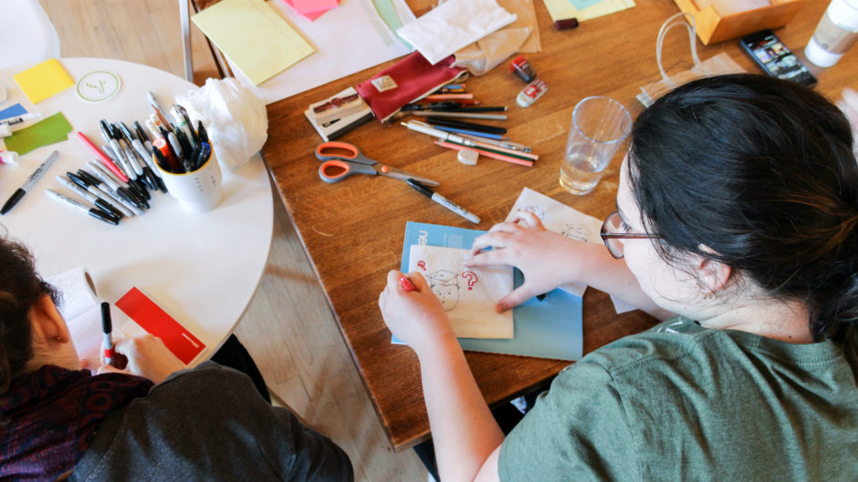 UX designers sketching ideas for things that need to be redesigned