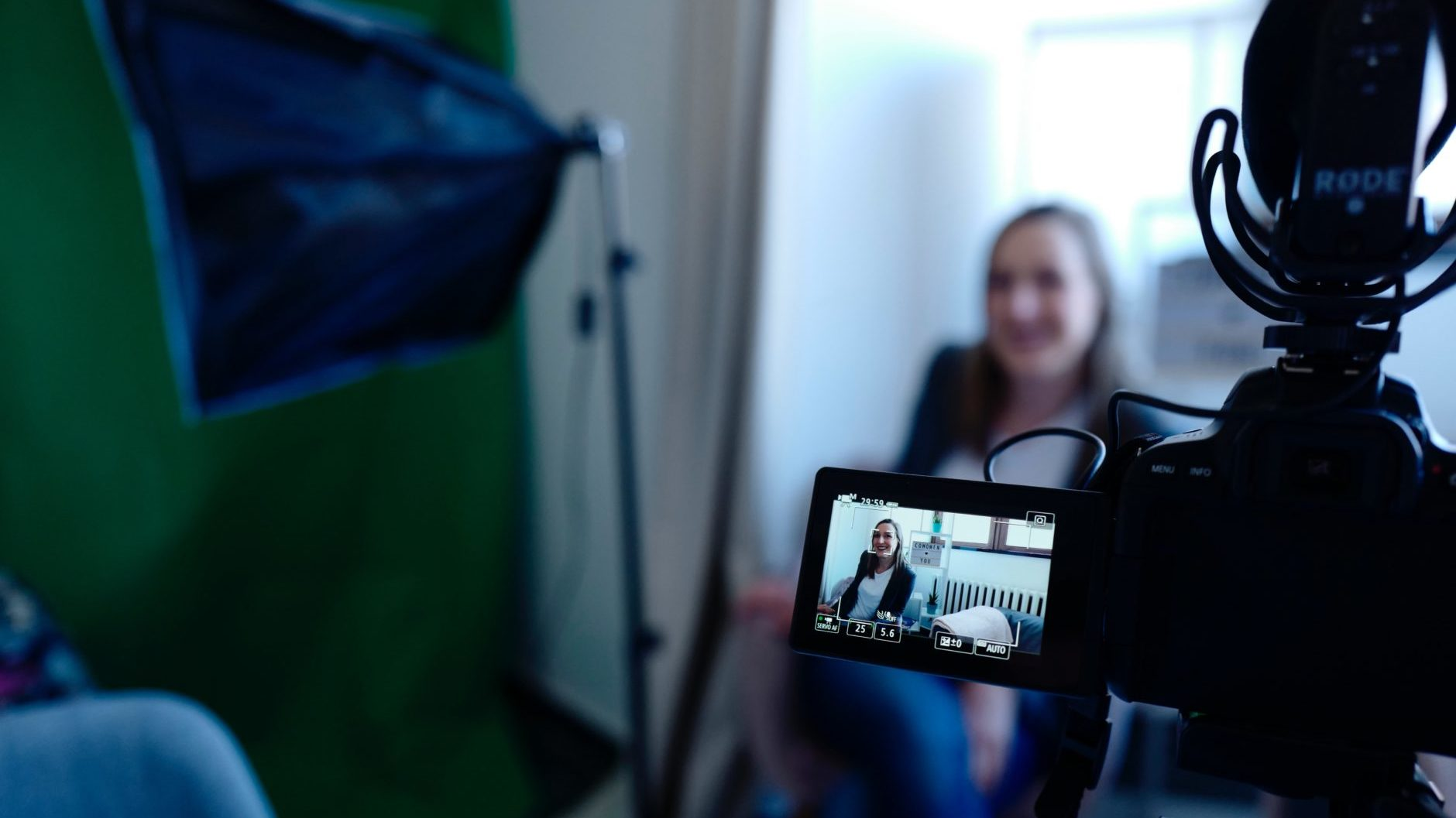 A woman is being recorded for a user interview
