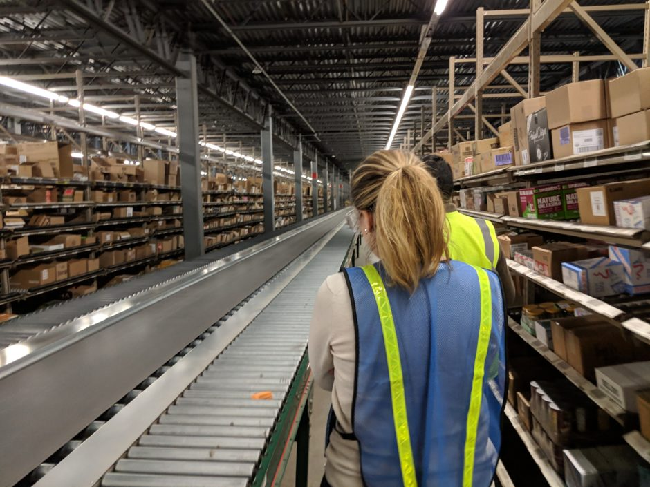 Fuzzy Math researcher conducting in-context research in a warehouse. Initial research is an important step in developing a clear digital transformation strategy.