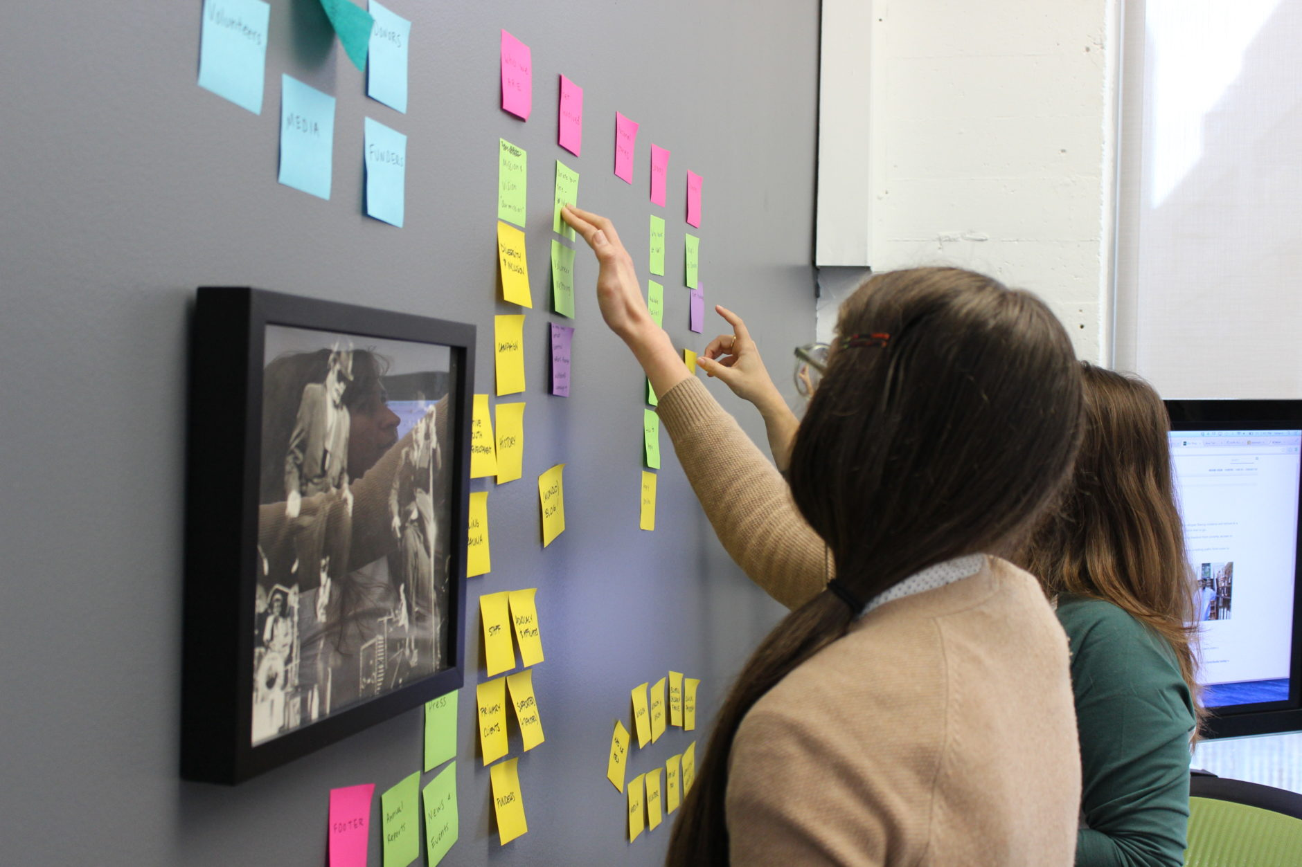 How to create an awesome product strategy - teammates working with sticky notes